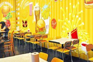 Nhắc tới màu sắc thiết kế nhà hàng ăn nhanh bạn sẽ nghĩ ngay tới gam màu đặc trưng như cam, đỏ, vàng.